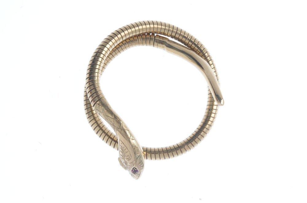 A 9ct gold snake bangle. Designed as an engraved snake - 3