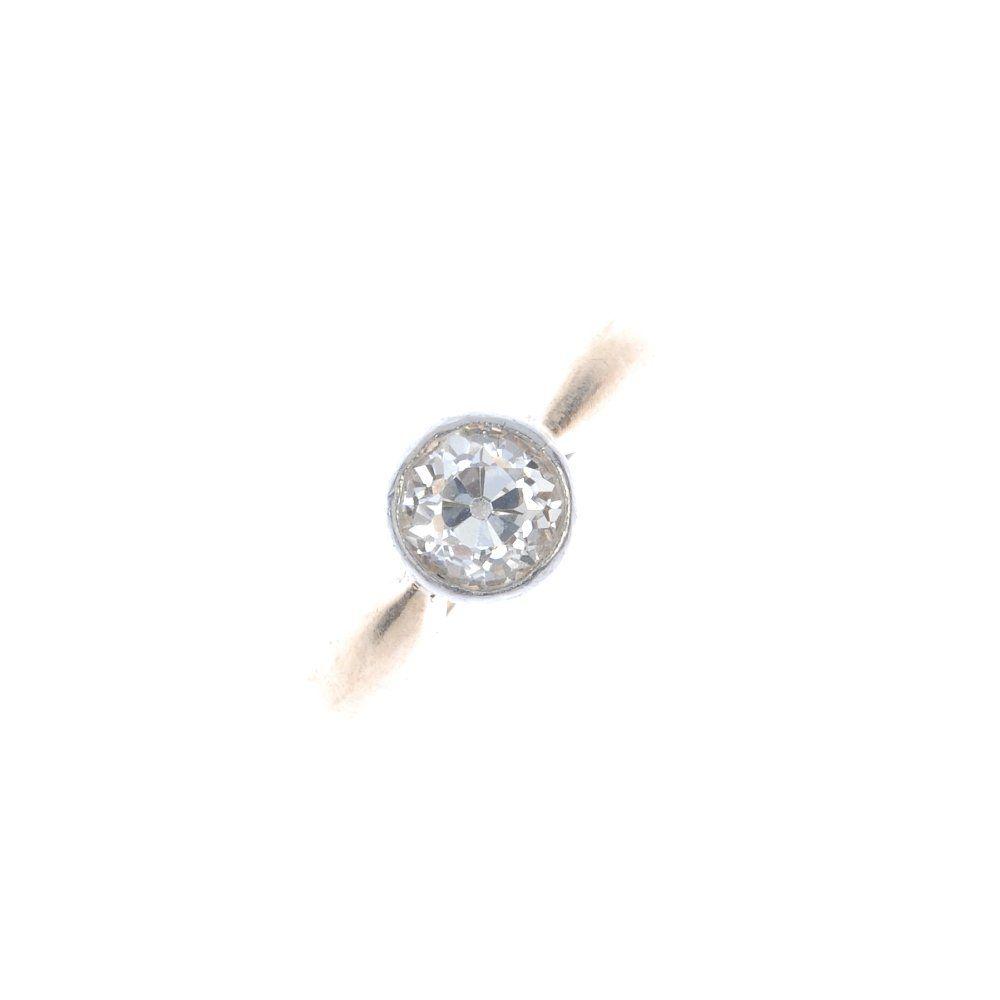 A mid 20th century gold diamond single-stone ring. The