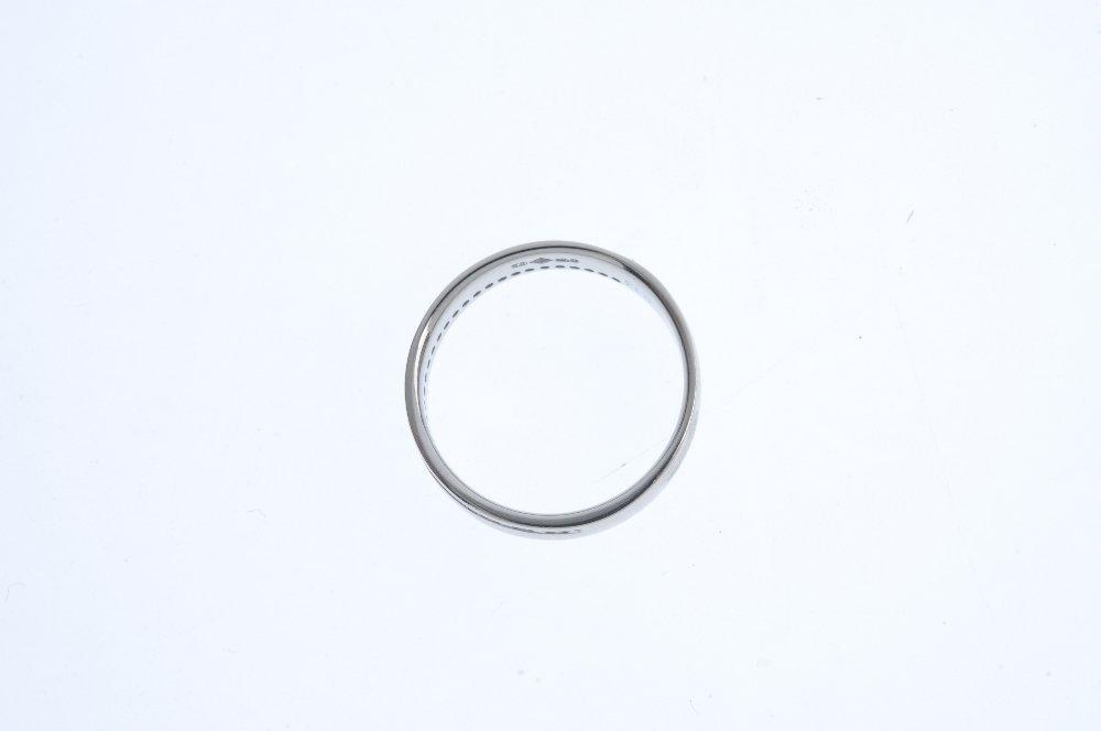 An 18ct gold diamond half-circle band ring. The - 2