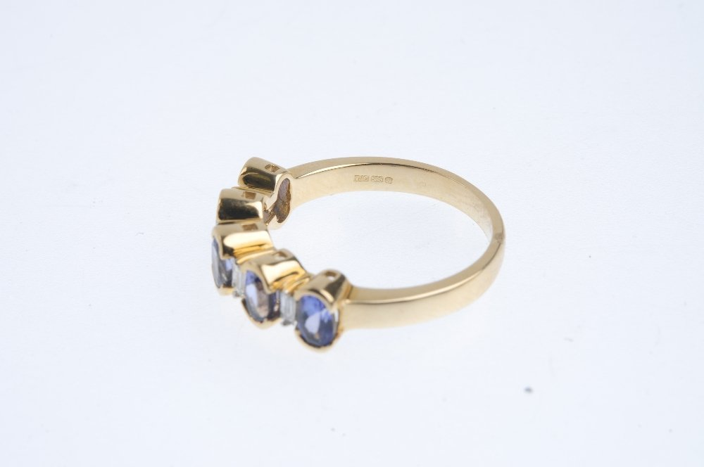 A 14ct gold tanzanite five-stone ring. The oval-shape - 3