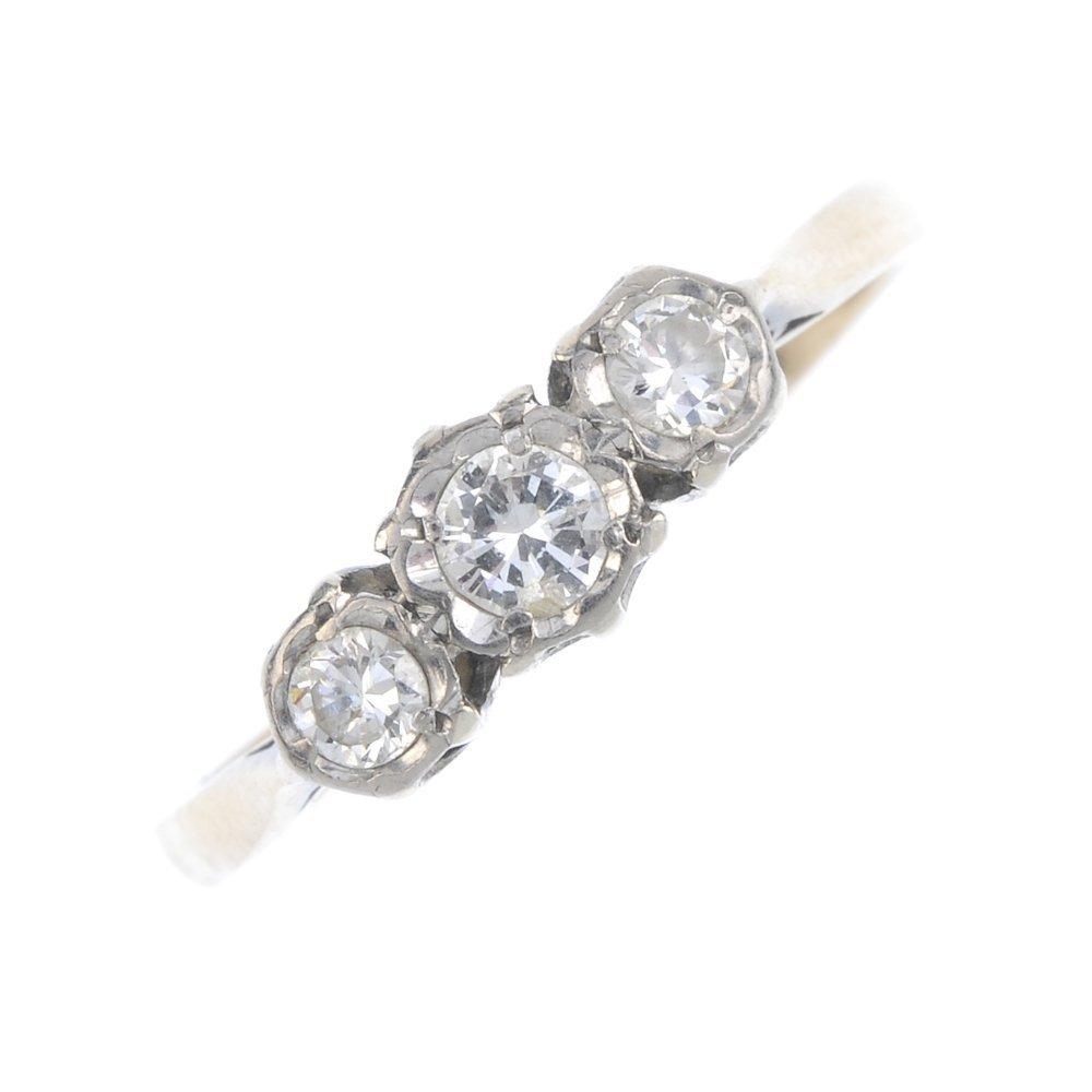 A 9ct gold diamond three-stone ring. The graduated