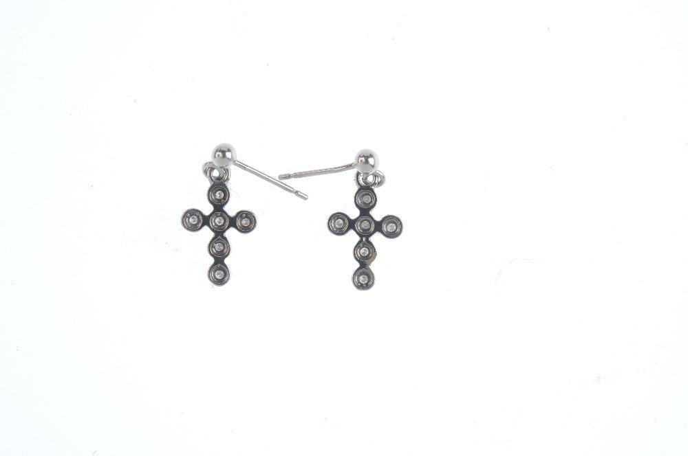A pair of diamond cross earrings. Each designed as a - 2