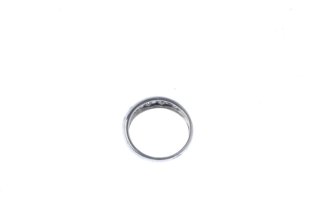 An 18ct gold diamond band ring. Designed as a series of - 3
