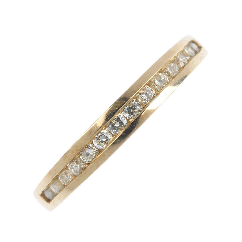 A 14ct gold diamond half-circle eternity ring. The