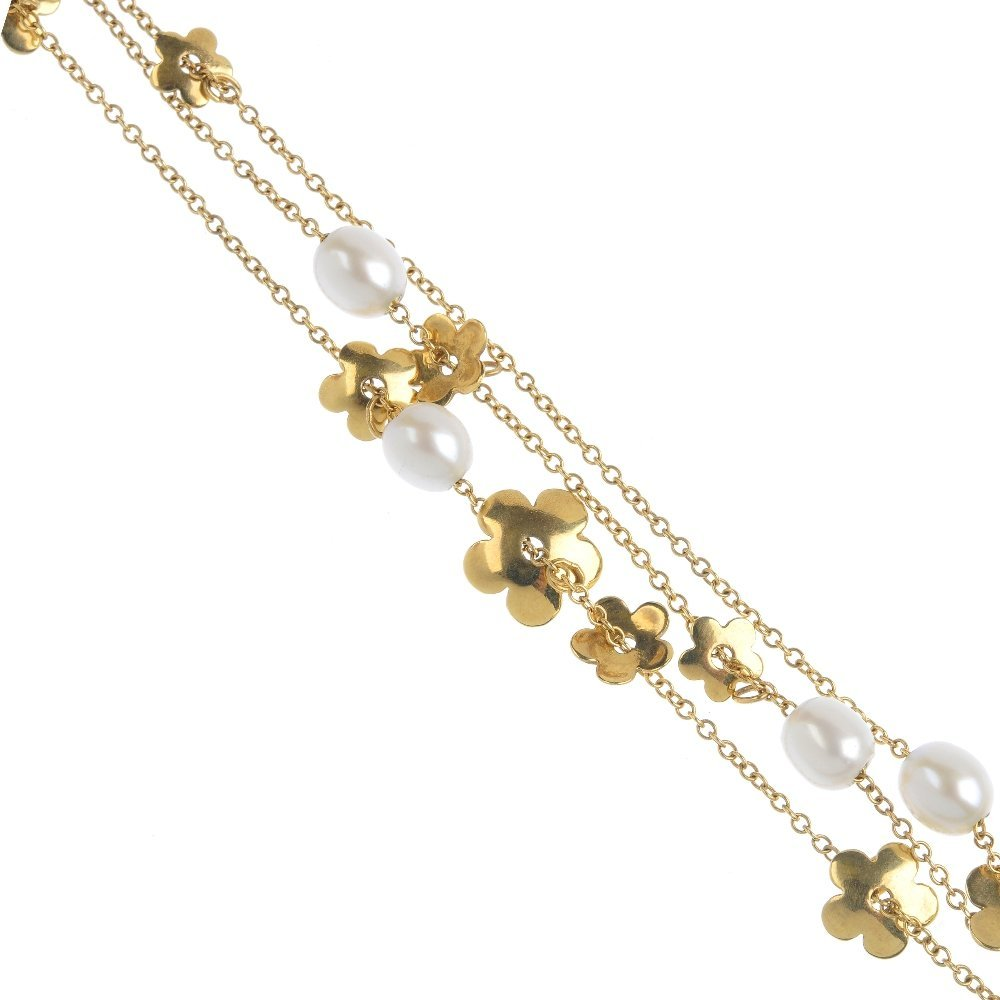 An 18ct gold and cultured pearl bracelet. Designed as