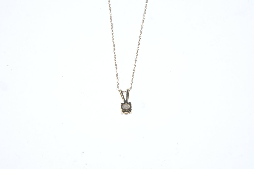 A diamond pendant. The brilliant-cut diamond, suspended - 2