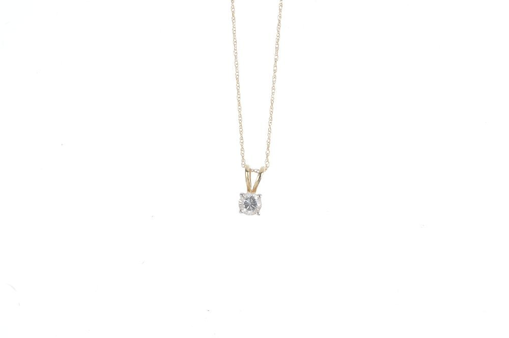 A diamond pendant. The brilliant-cut diamond, suspended - 4