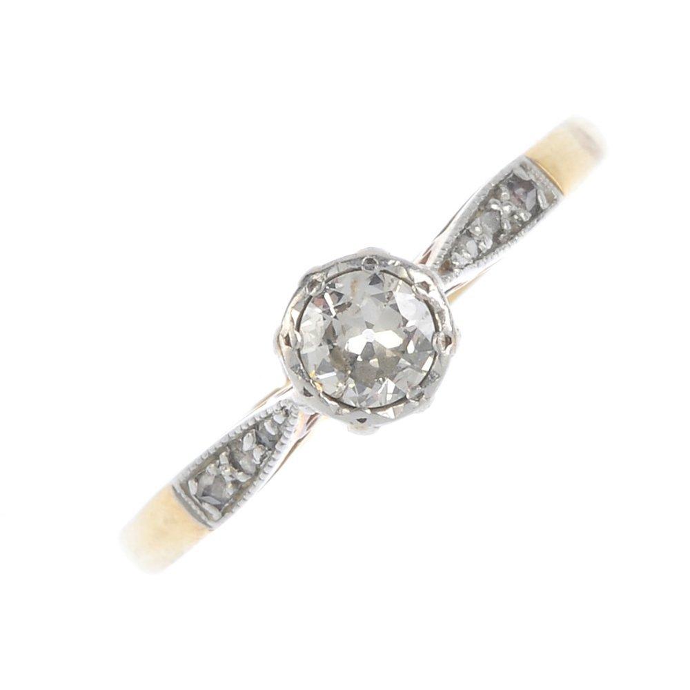 A diamond single-stone ring. The circular-cut diamond,