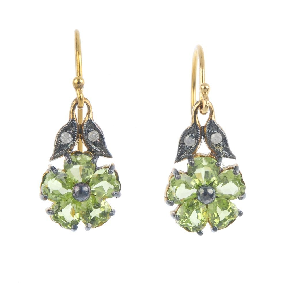 A pair of peridot and diamond earrings. Each designed