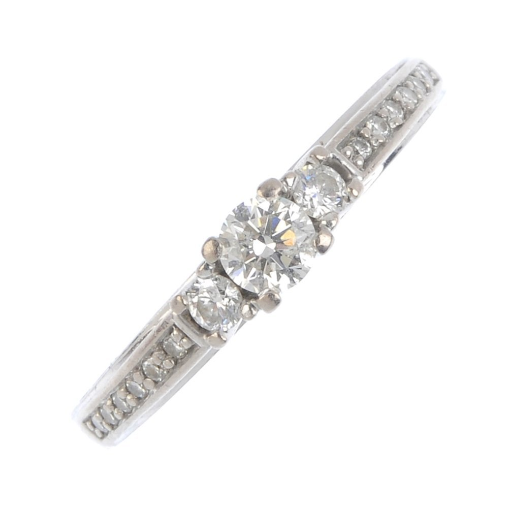 An 18ct gold diamond ring. The slightly graduated