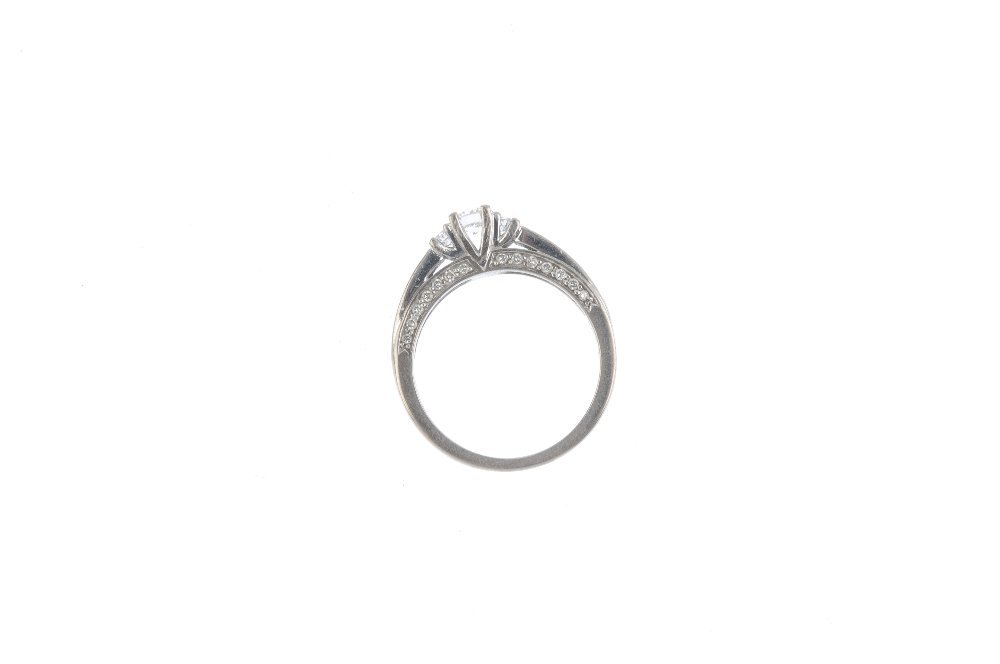 An 18ct gold diamond ring. The slightly graduated - 2