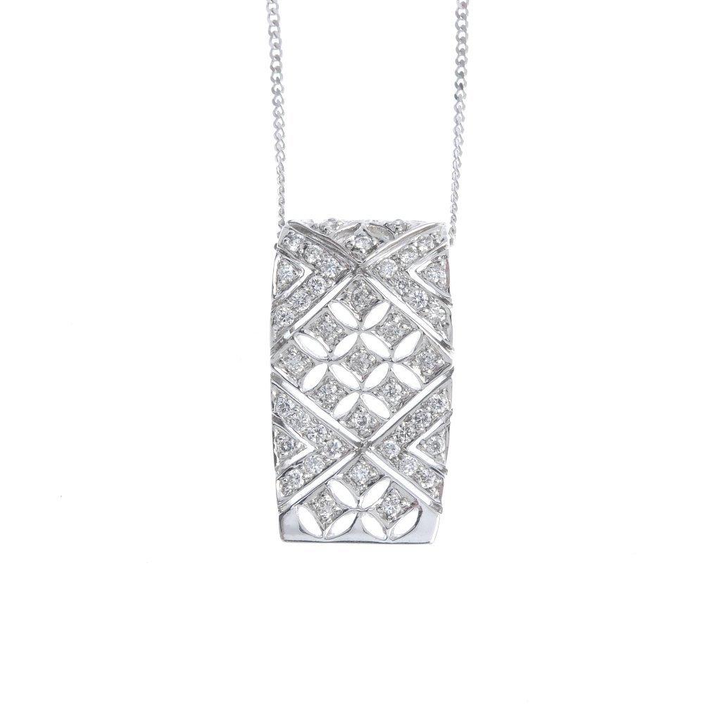 An 18ct gold diamond pendant. The pave-set diamond