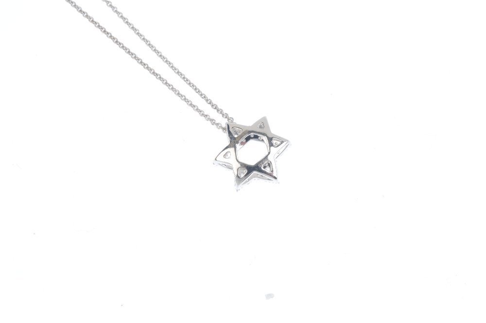 An 18ct gold diamond Star of David pendant, with chain. - 3