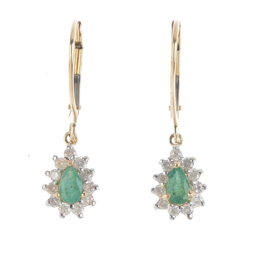 A pair of emerald and diamond ear pendants. Each