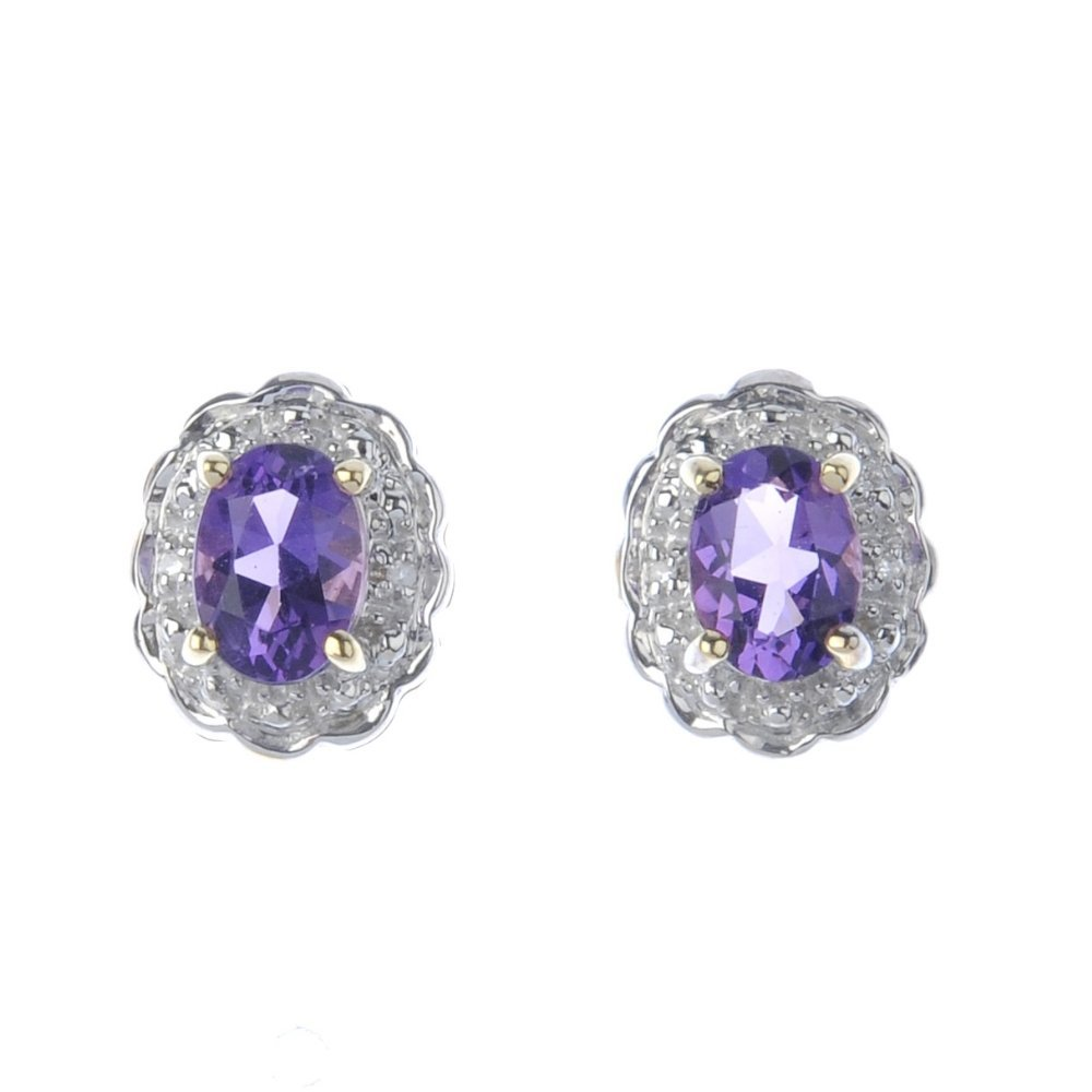A pair of 9ct gold amethyst and diamond cluster