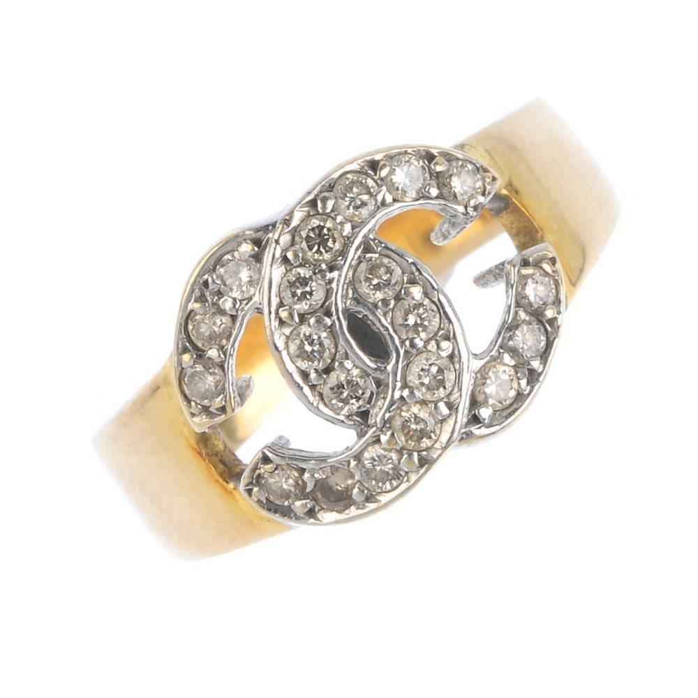 A diamond dress ring. Of bi-colour design, the two