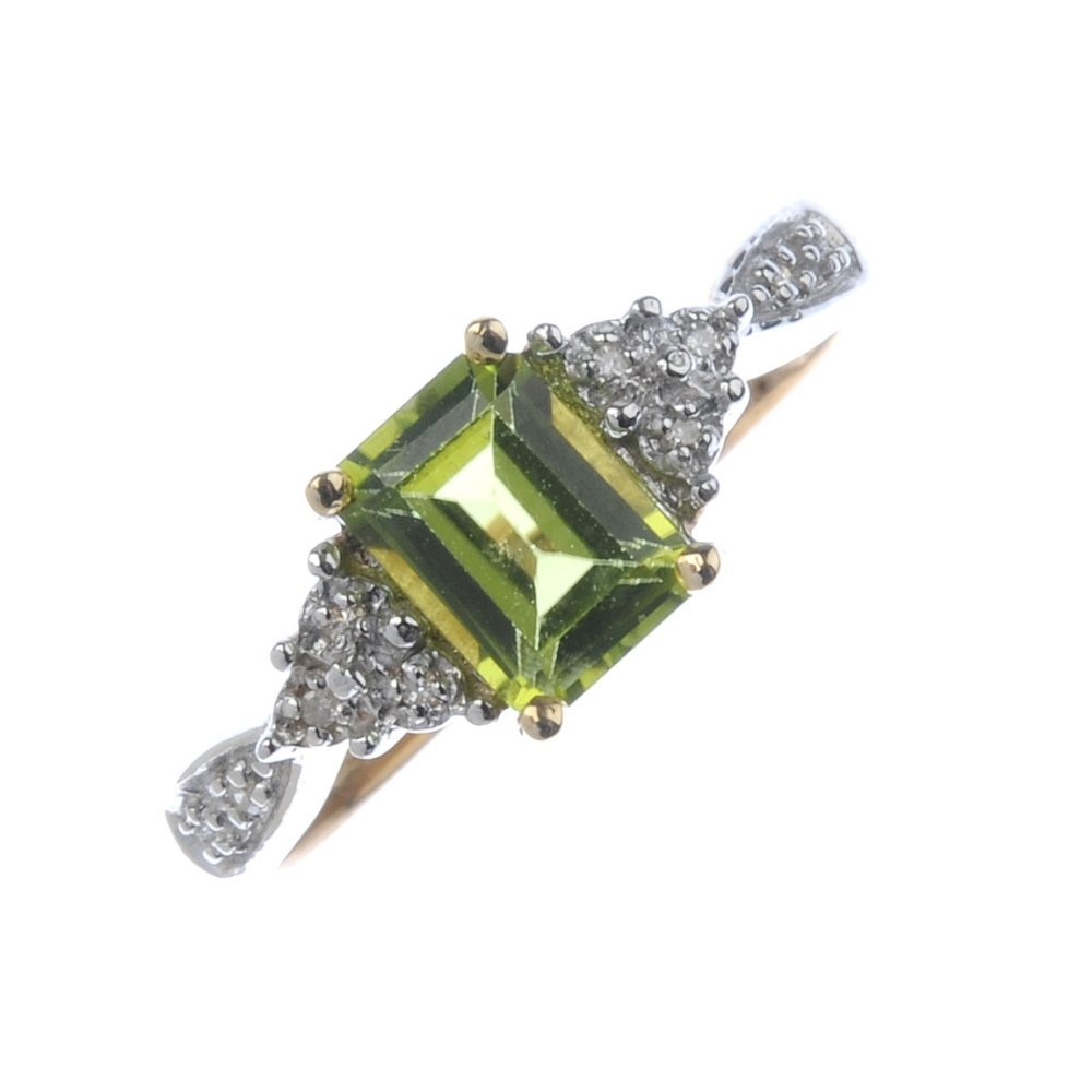A 9ct gold peridot and diamond ring. The