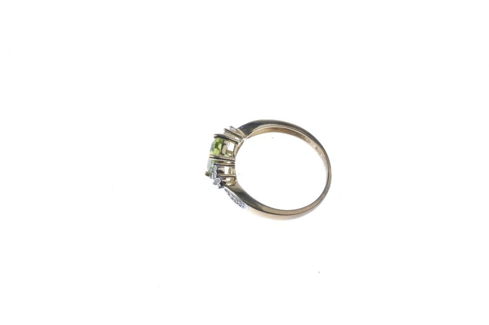 A 9ct gold peridot and diamond ring. The - 2