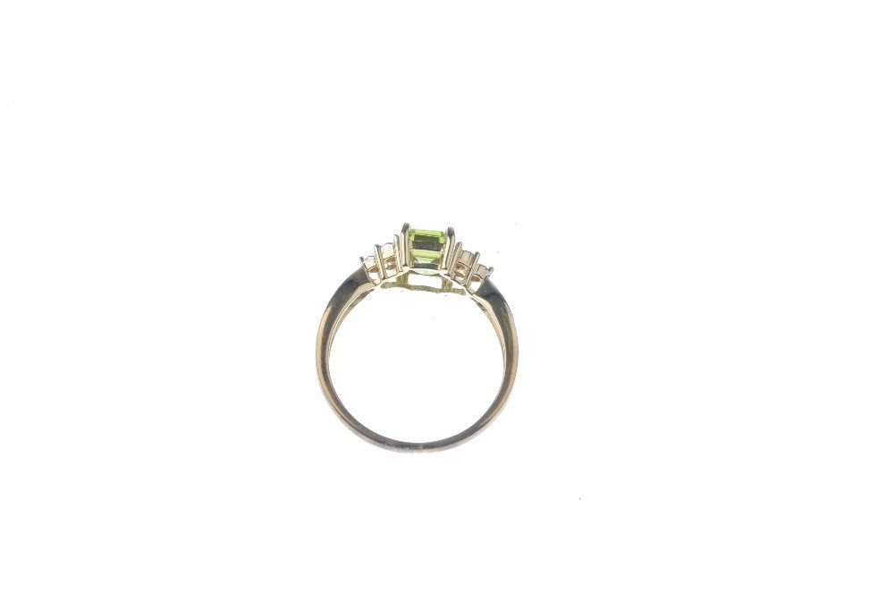 A 9ct gold peridot and diamond ring. The - 3