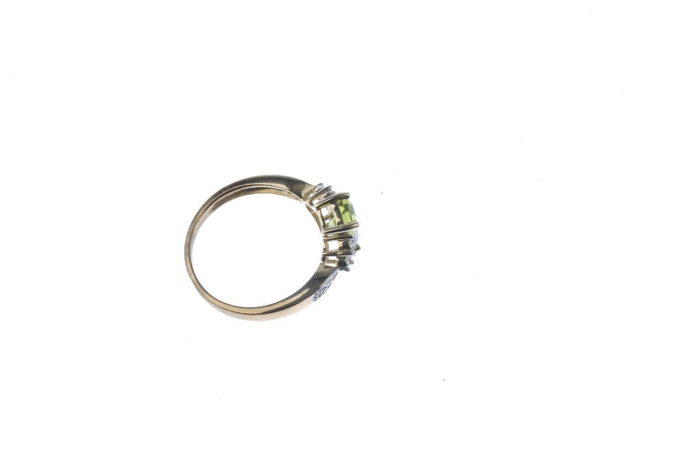 A 9ct gold peridot and diamond ring. The - 4