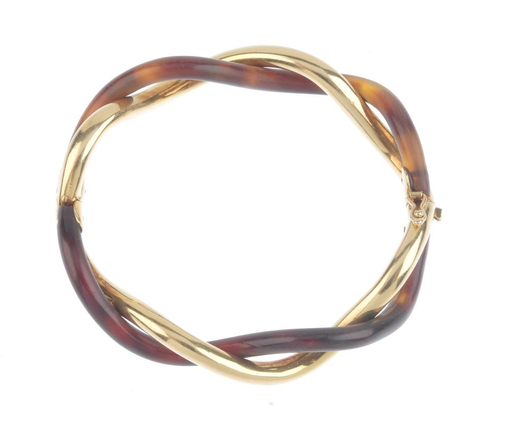 (545050-2-A) An 18ct gold and horn hinged bangle. - 2