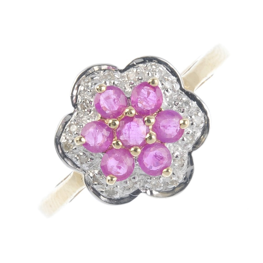 A 9ct gold ruby and diamond floral cluster ring. The