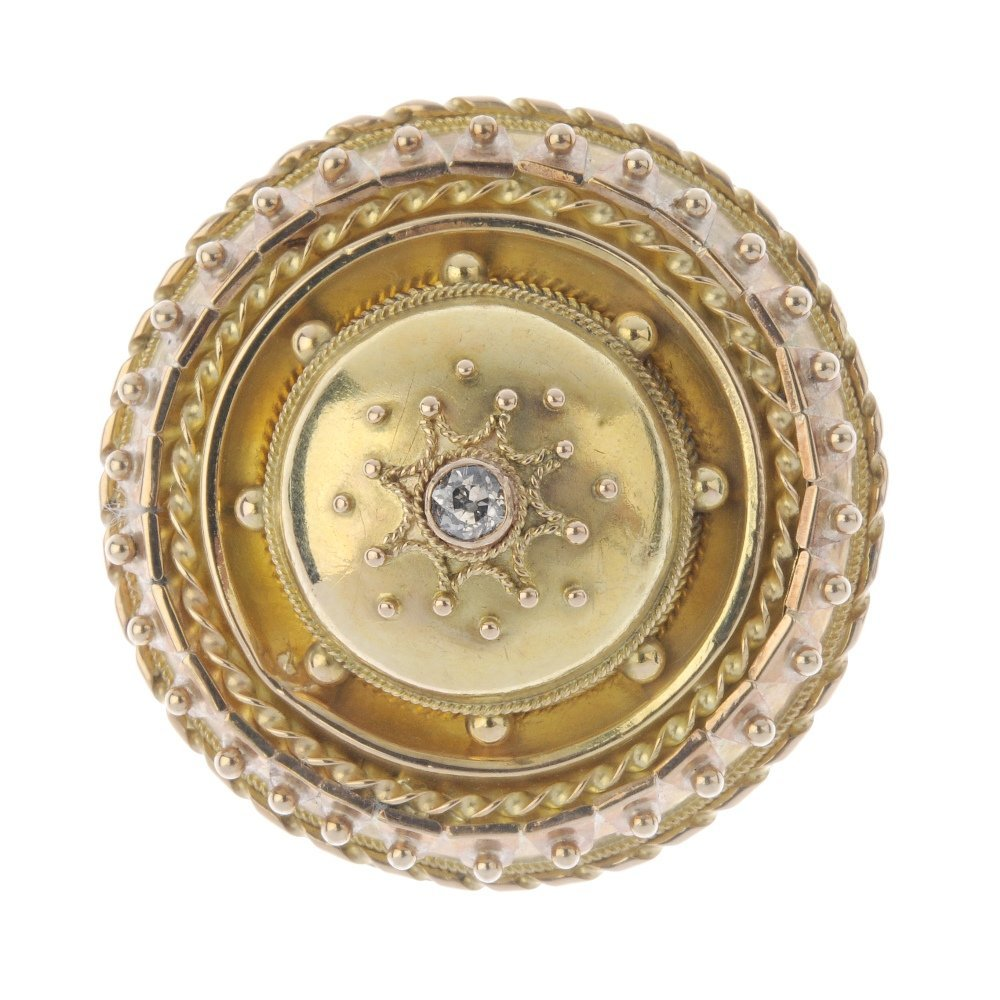A late Victorian gold diamond brooch. The old-cut dome,