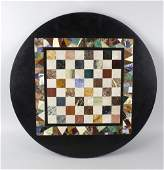 A Pietra Dura games table top of circular form having
