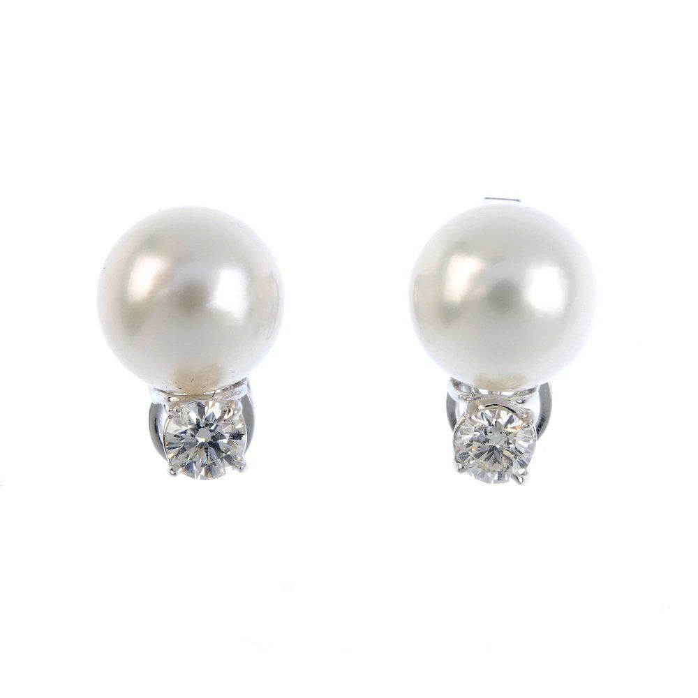 A pair of cultured pearl and diamond ear clips. Each