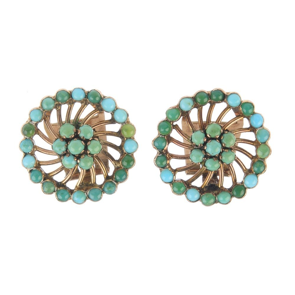 A pair of turquoise ear clips. Each designed as a