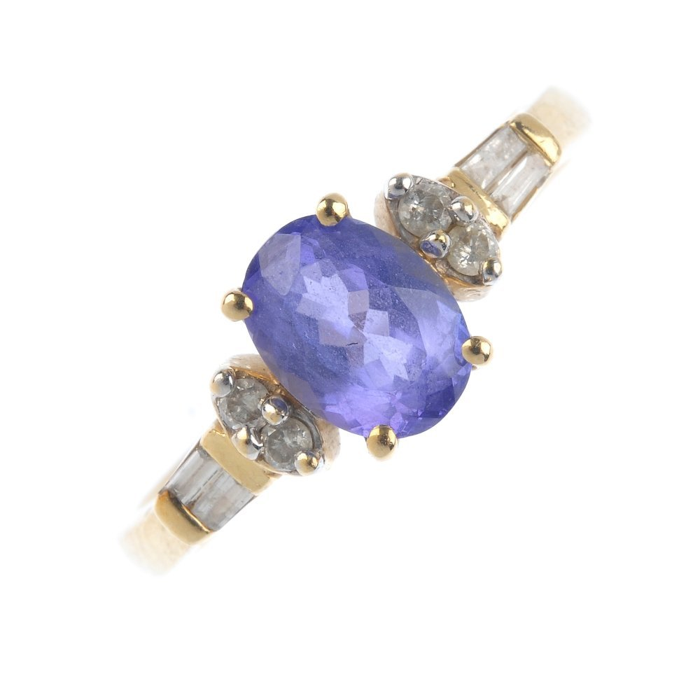 A 14ct gold tanzanite and diamond dress ring. The