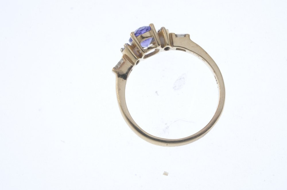A 14ct gold tanzanite and diamond dress ring. The - 2