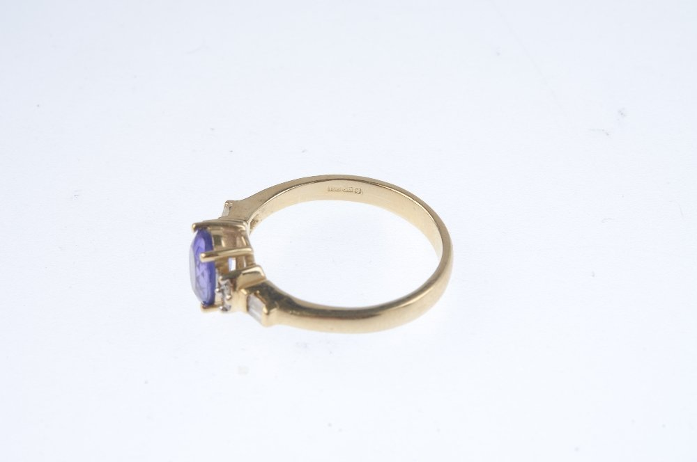 A 14ct gold tanzanite and diamond dress ring. The - 3