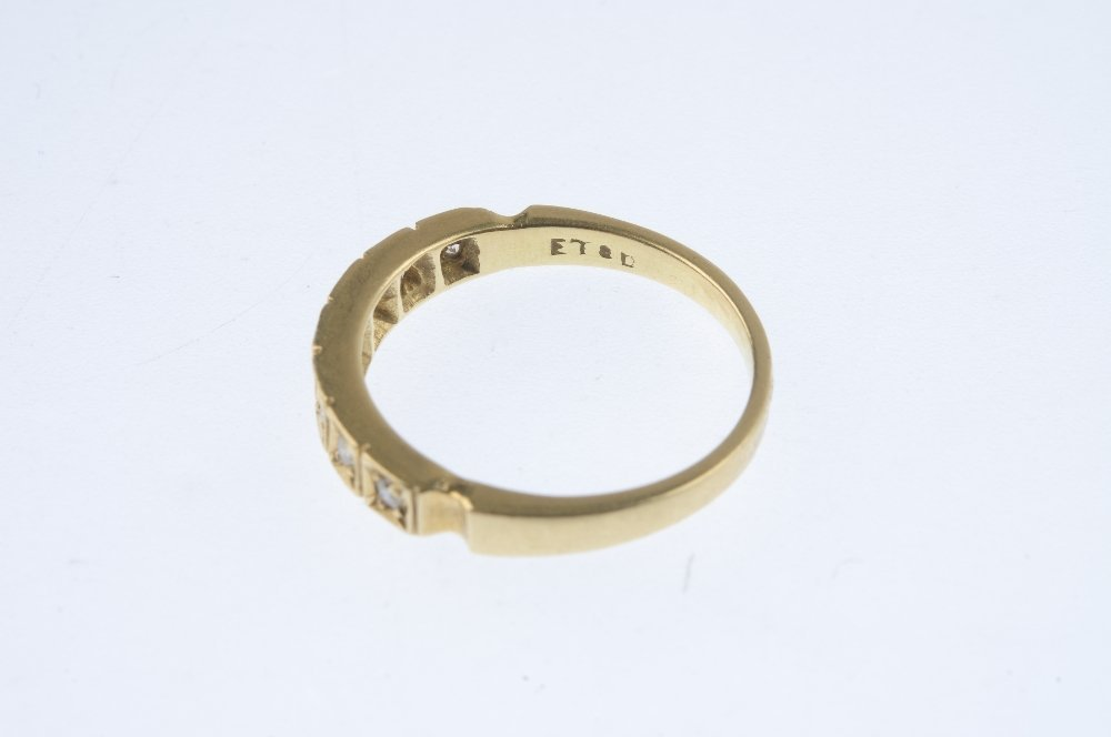 An 18ct gold diamond ring. Designed as a graduated - 3