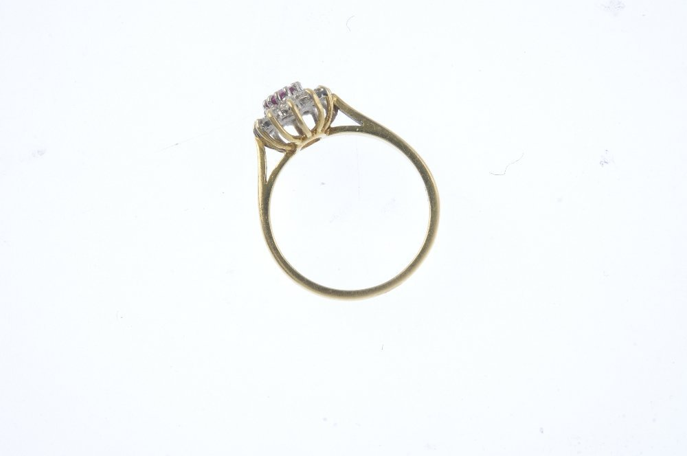 An 18ct gold ruby and diamond cluster ring. The - 2