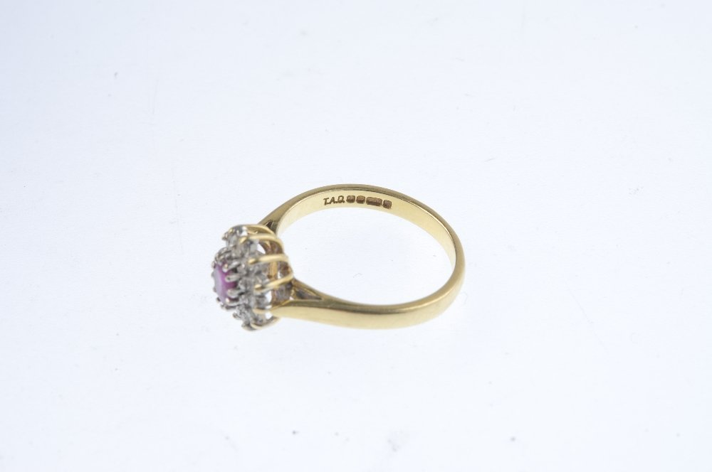 An 18ct gold ruby and diamond cluster ring. The - 3