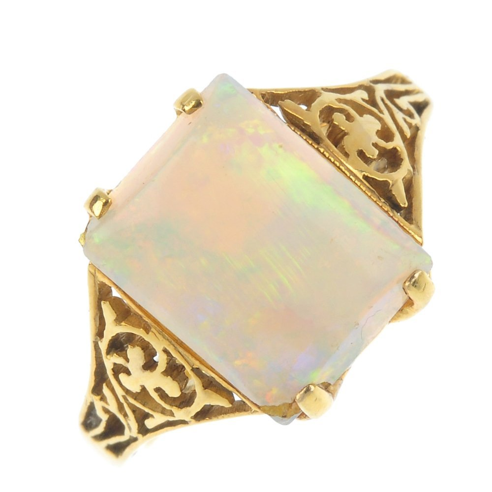 An opal single-stone ring, AF. The rectangular opal