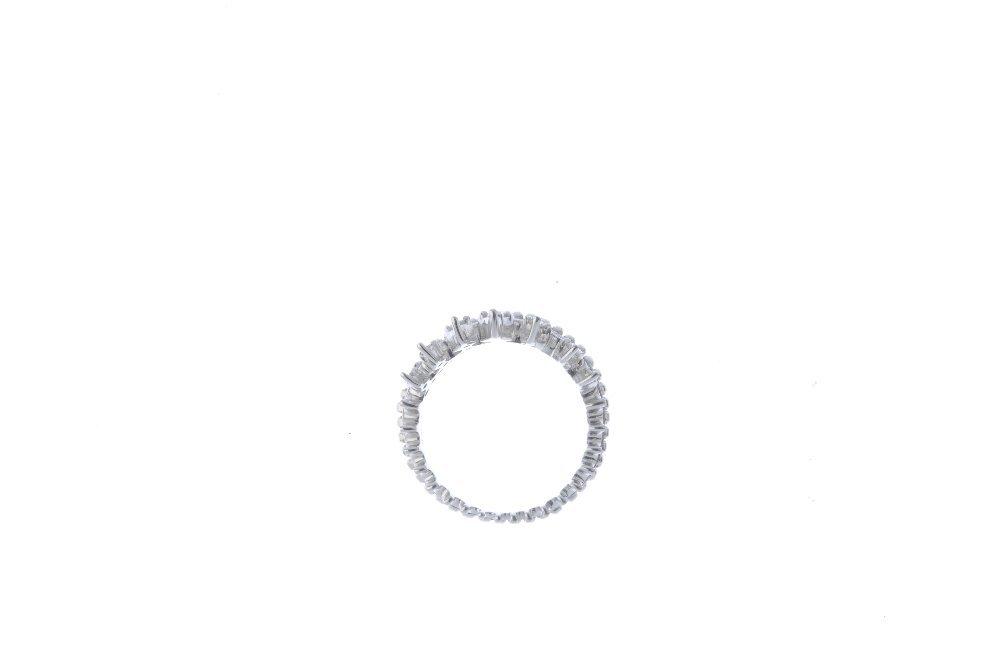 An 18ct gold diamond dress ring. Designed as a circular - 2
