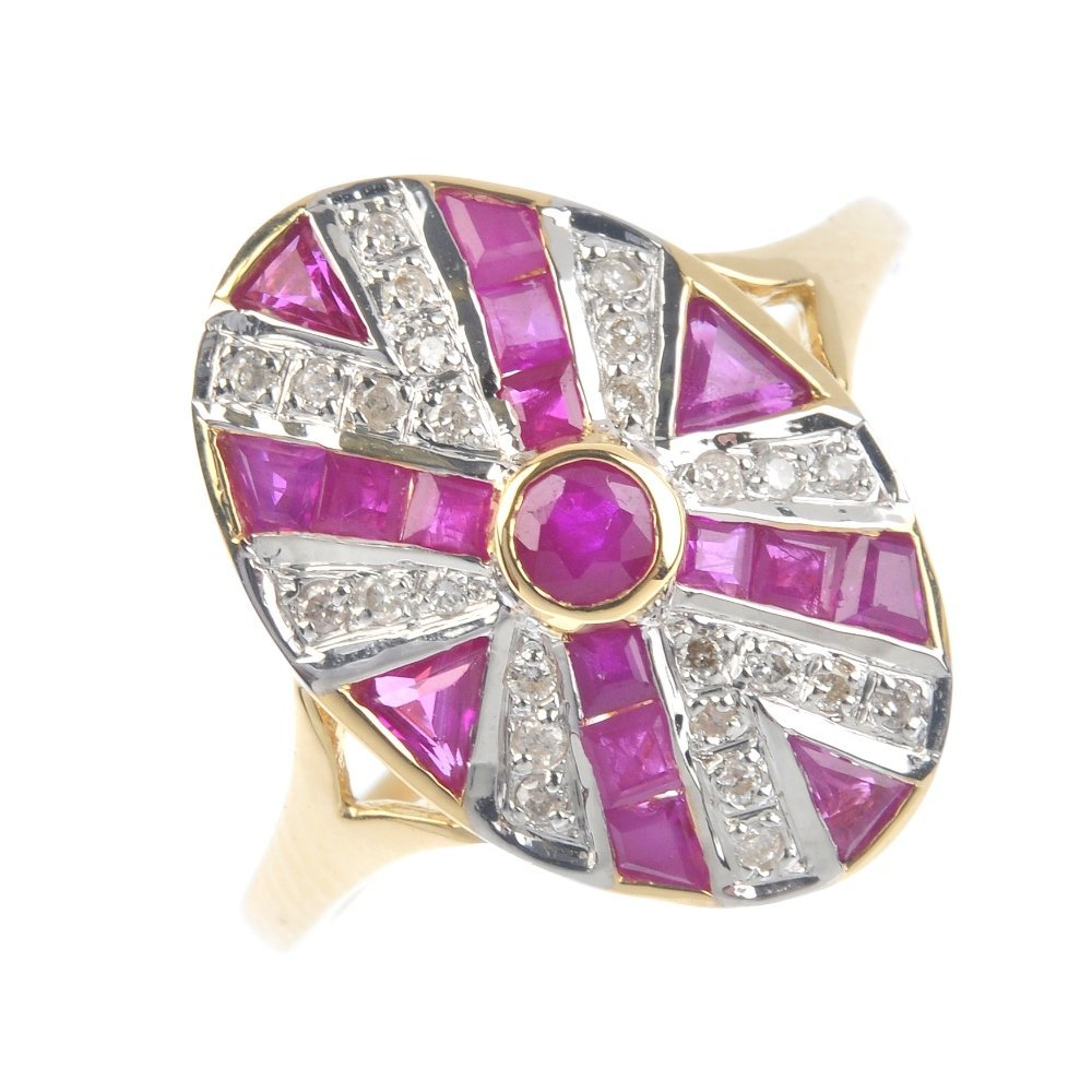 A ruby and diamond dress ring. Of oval outline, the