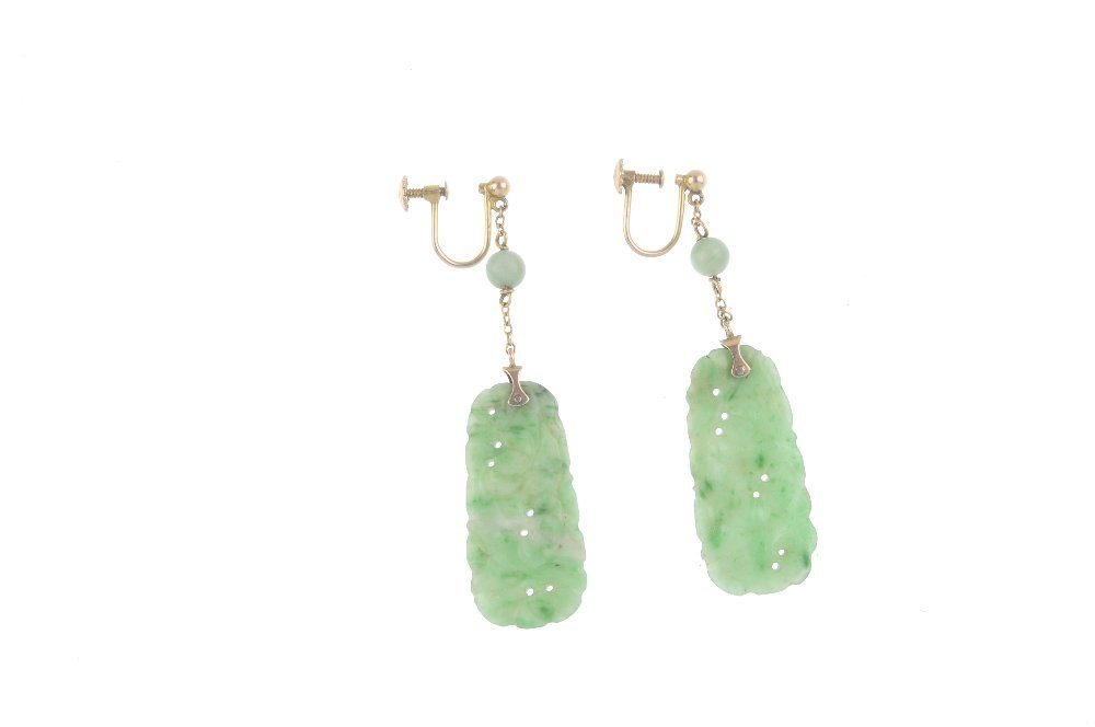 A pair of jade earrings. Each designed as a carved and - 2
