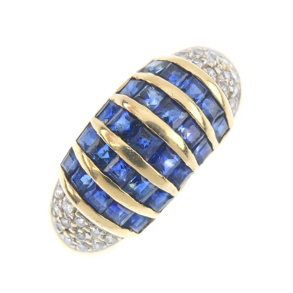 A 14ct gold sapphire and diamond dress ring. Comprising