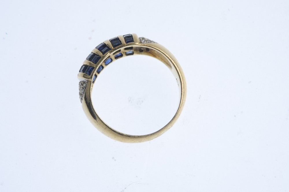 A 14ct gold sapphire and diamond dress ring. Comprising - 2