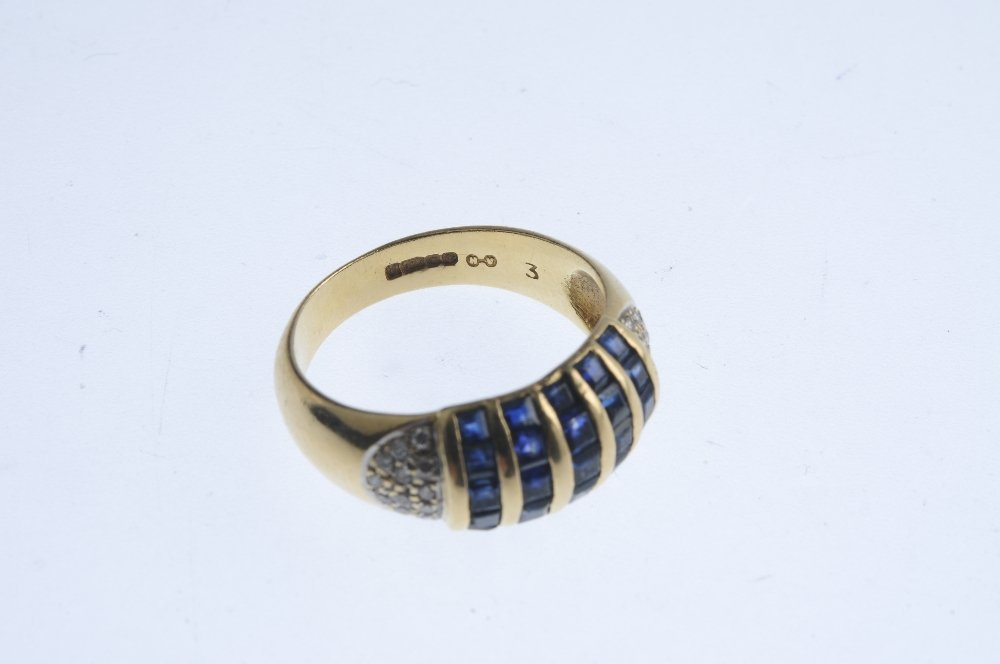 A 14ct gold sapphire and diamond dress ring. Comprising - 3