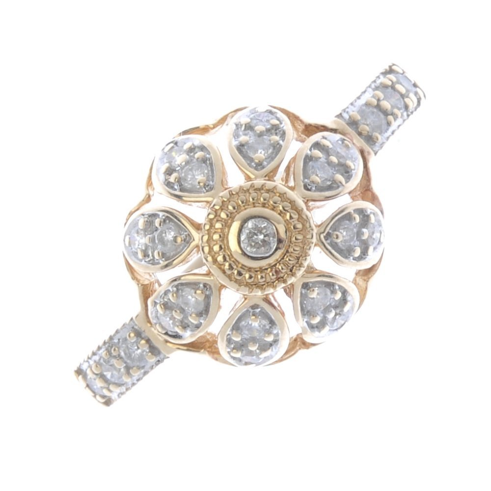 A 9ct gold diamond cluster ring. Of openwork design,
