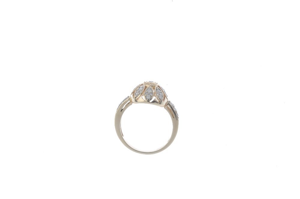 A 9ct gold diamond cluster ring. Of openwork design, - 2