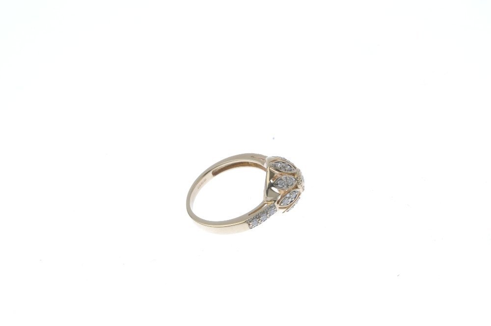 A 9ct gold diamond cluster ring. Of openwork design, - 4