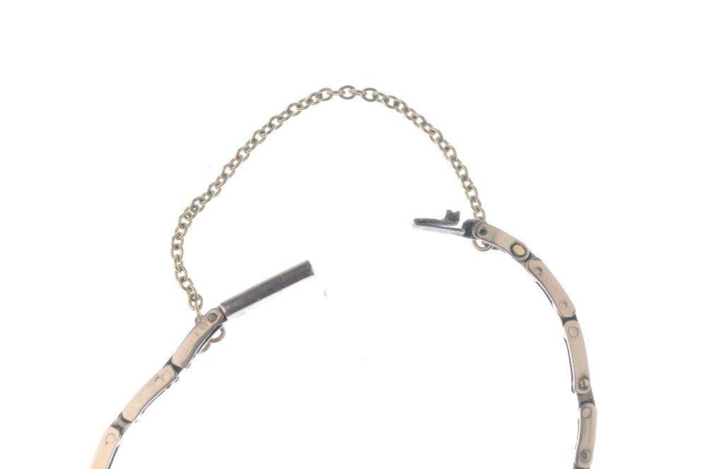 An early 20th century gold garnet bracelet. Designed as - 3
