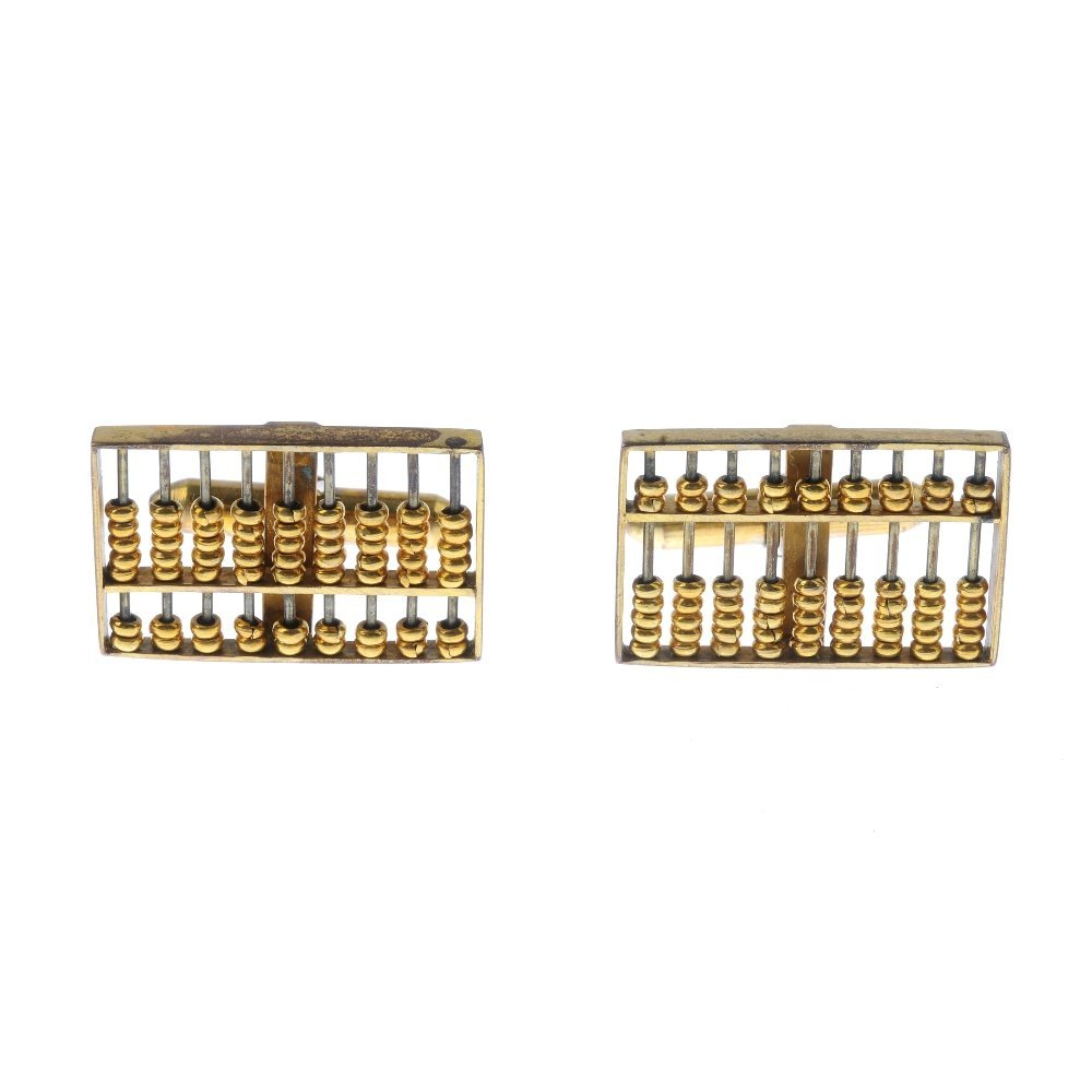 A pair of Abacus cufflinks. Each designed as an Abacus,