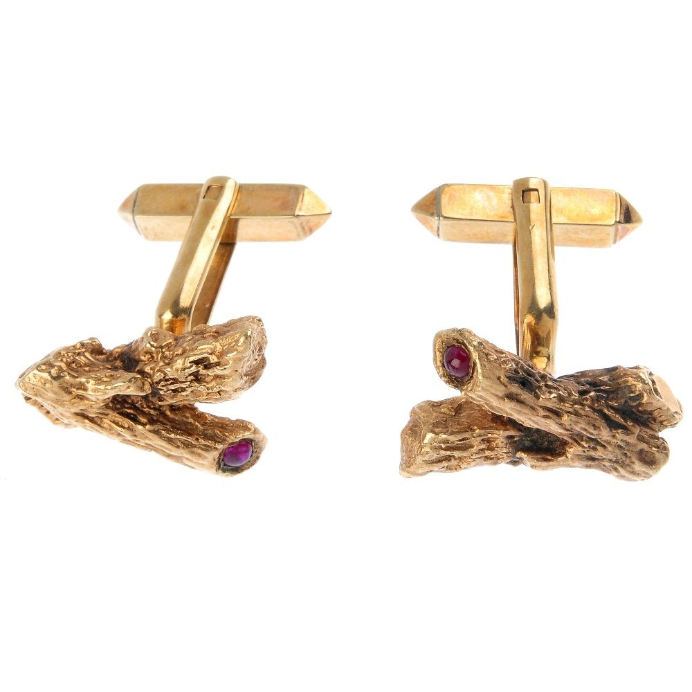 A pair of 1960s 9ct gold ruby cufflinks. Each designed