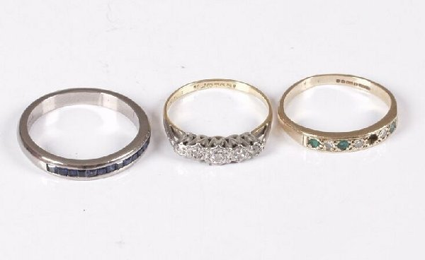 4: Three rings to include an 18ct white gold channel se